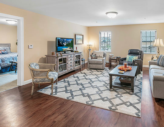 Parkview Senior Living deluxe 1-bedroom with living room view.