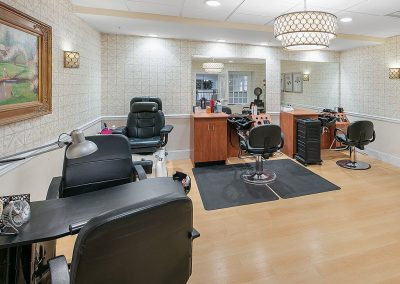 Full-service barber shop and beauty salon with manicure and pedicure station.